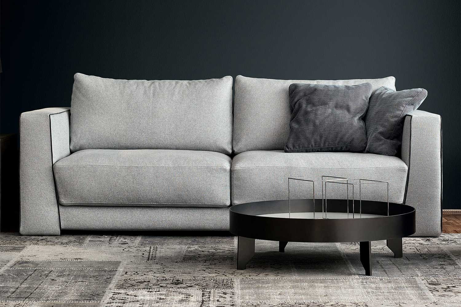 A modern high arm sectional sofa with loose box cushion sectional sofa with feather filled box cushions