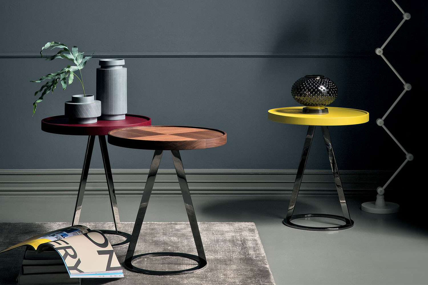 Contemporary 50 cm wide round side table with sculptural cone metal base in black chrome