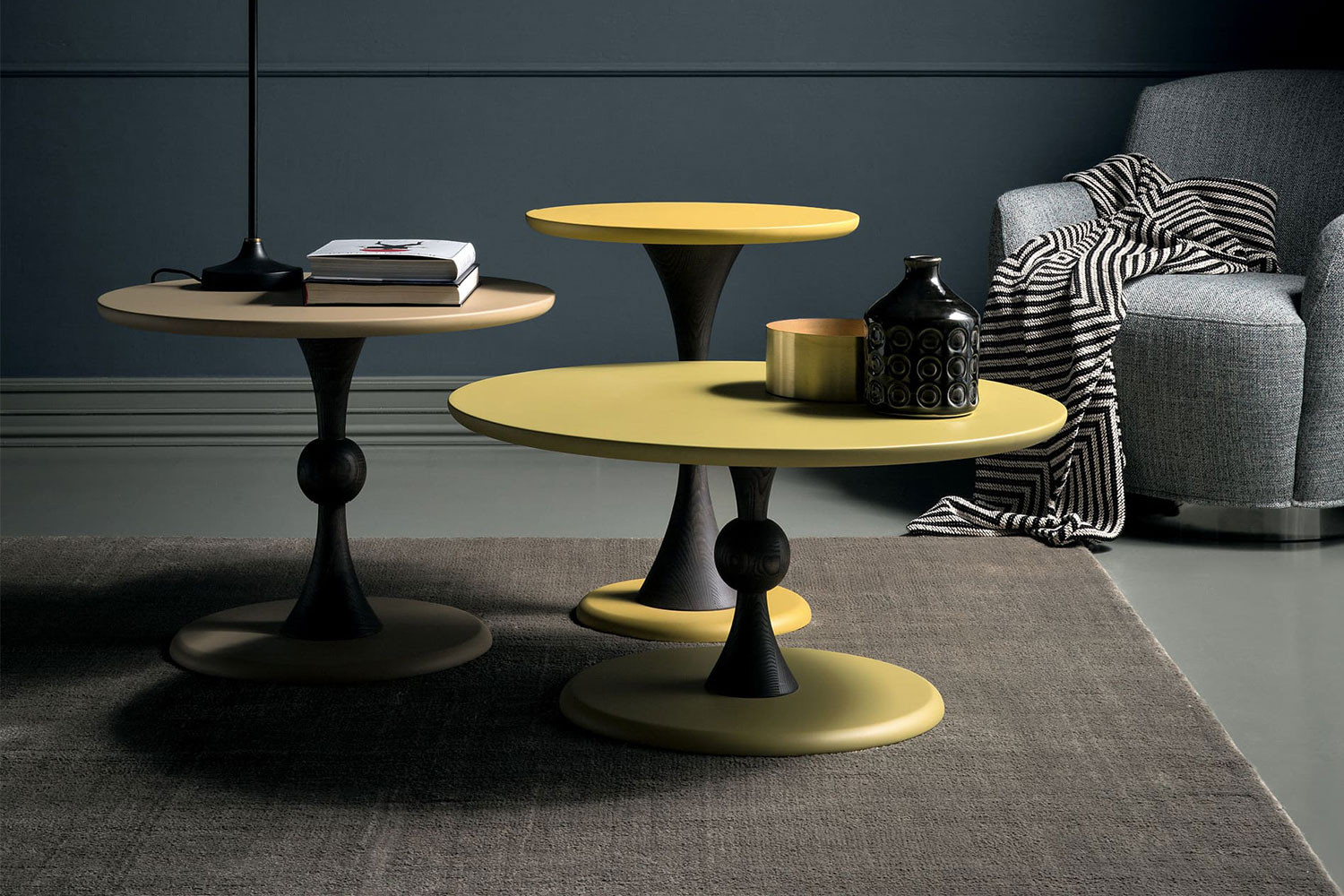 Contemporary turned wood pedestal side table with round top