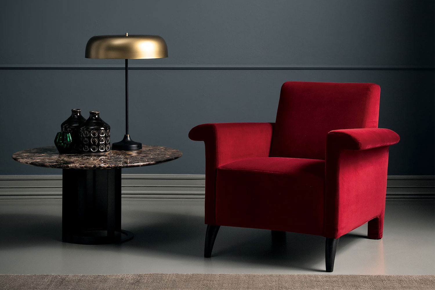 Single seat transitional armchair with winged arms and tapered legs