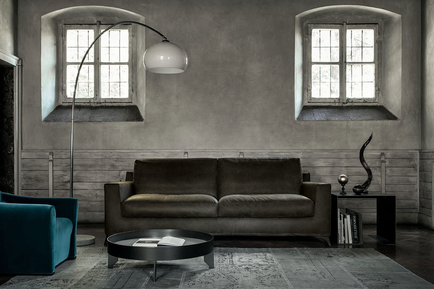 Sofa with solid wood legs and leather upholstery