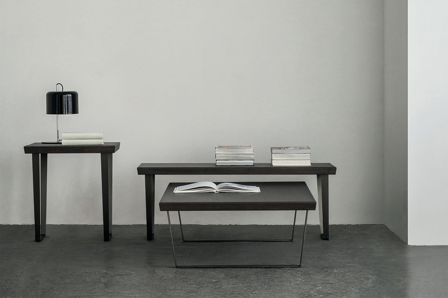 Low square or rectangular nesting coffee tables with chrome sled legs