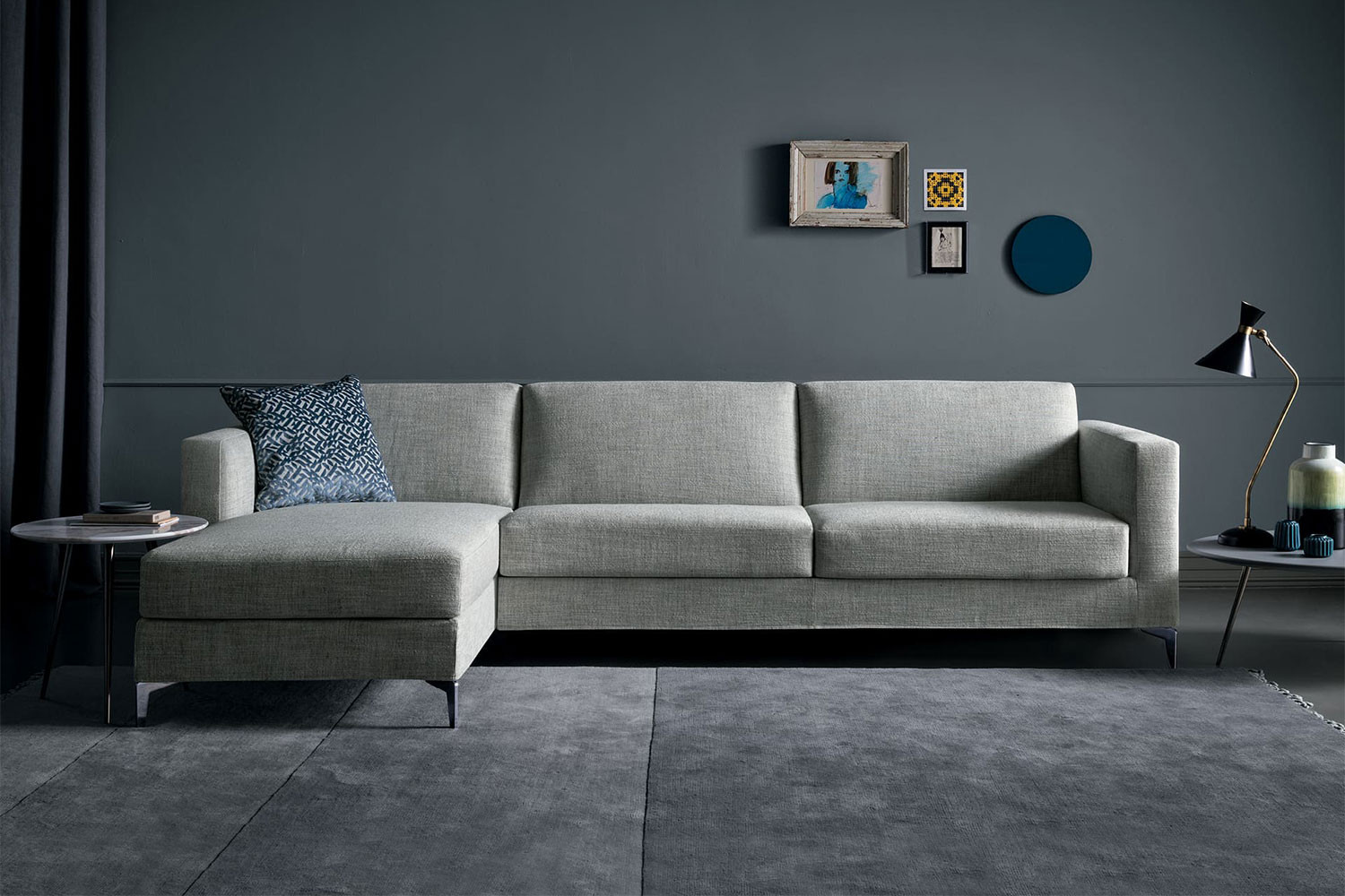 High sectional sofa bed with tapered metal legs and track arms