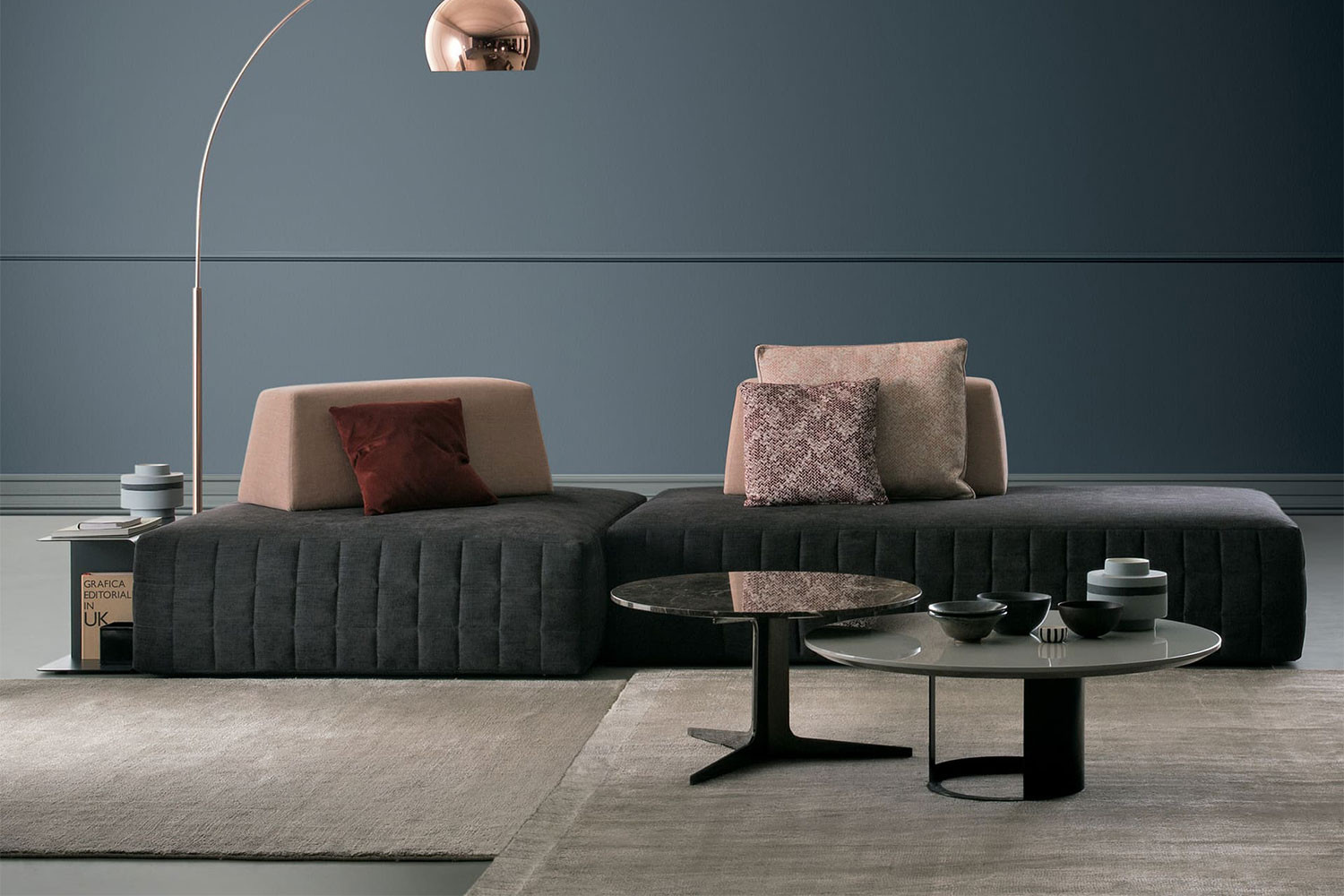 Bespoke low modular sofa, armless, backless, with legless floor skimming seats and weighted back cushions