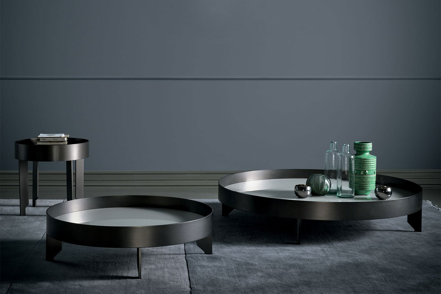 Contemporary round glass and metal coffee tables