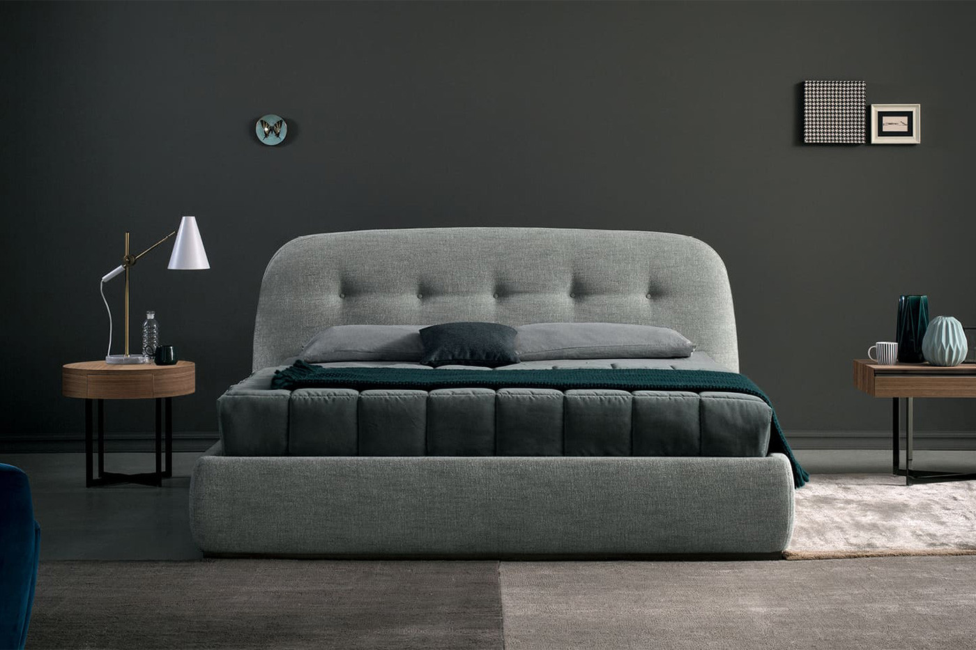 Upholstered king size bed with a button tufted, curved top headboard