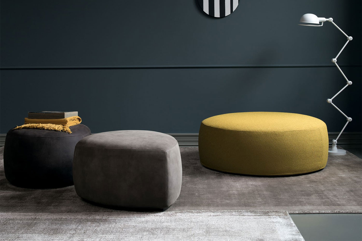 Contemporary, minimalist upholstered pouffes with a low wooden plinth base