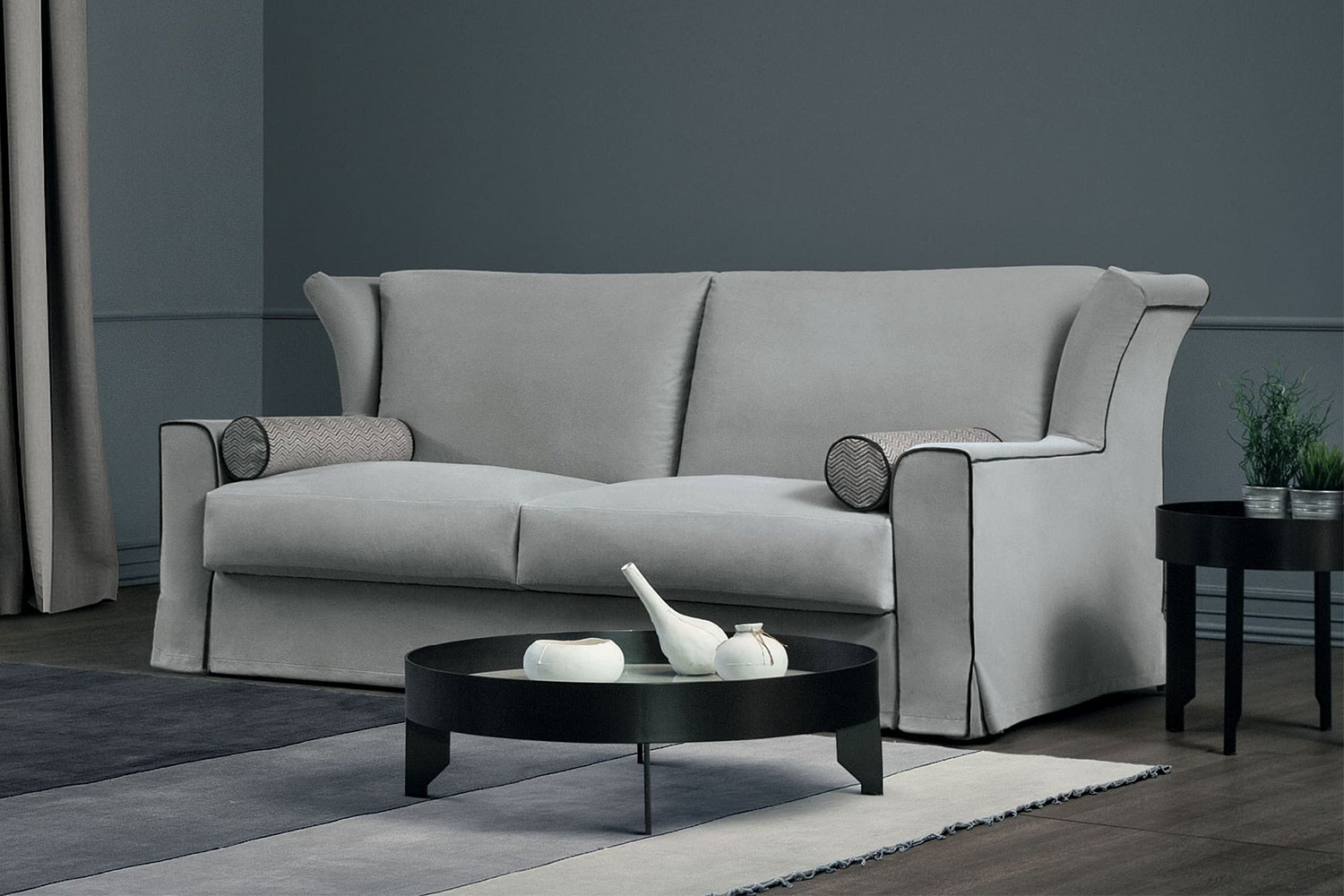 2, 3 seater traditional sofa bed with a modern wingback design and a kick pleat skirt