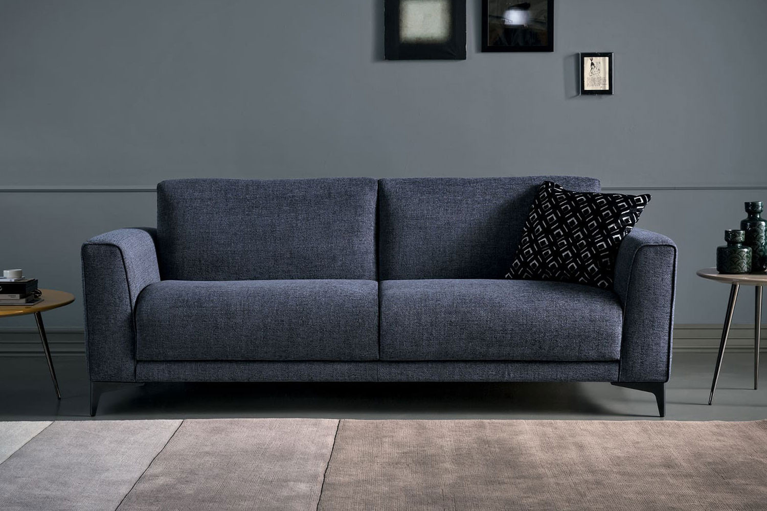 Stylish 2-3 seater sofa bed with high tapered metal legs, slightly flared arms and generous seat cushions