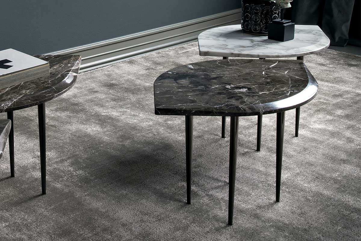 Leaf shaped marble side table with 4 slender tapered legs in black chrome