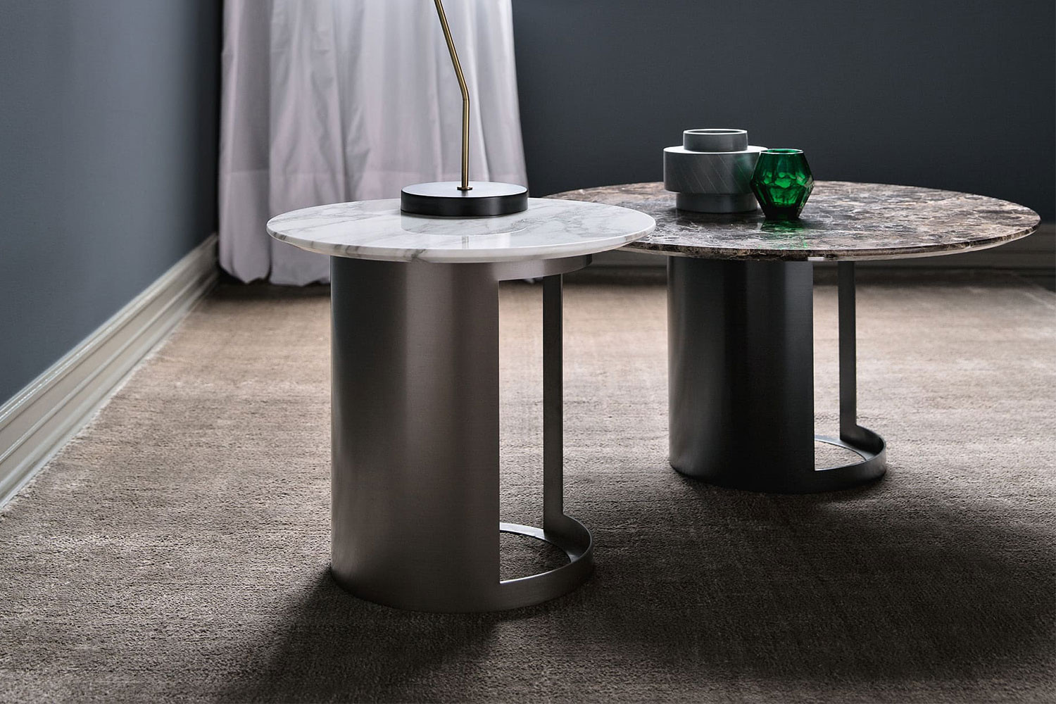 Marble side or coffee table with cut-out metal pedestal, in round, oval or barrel shapes