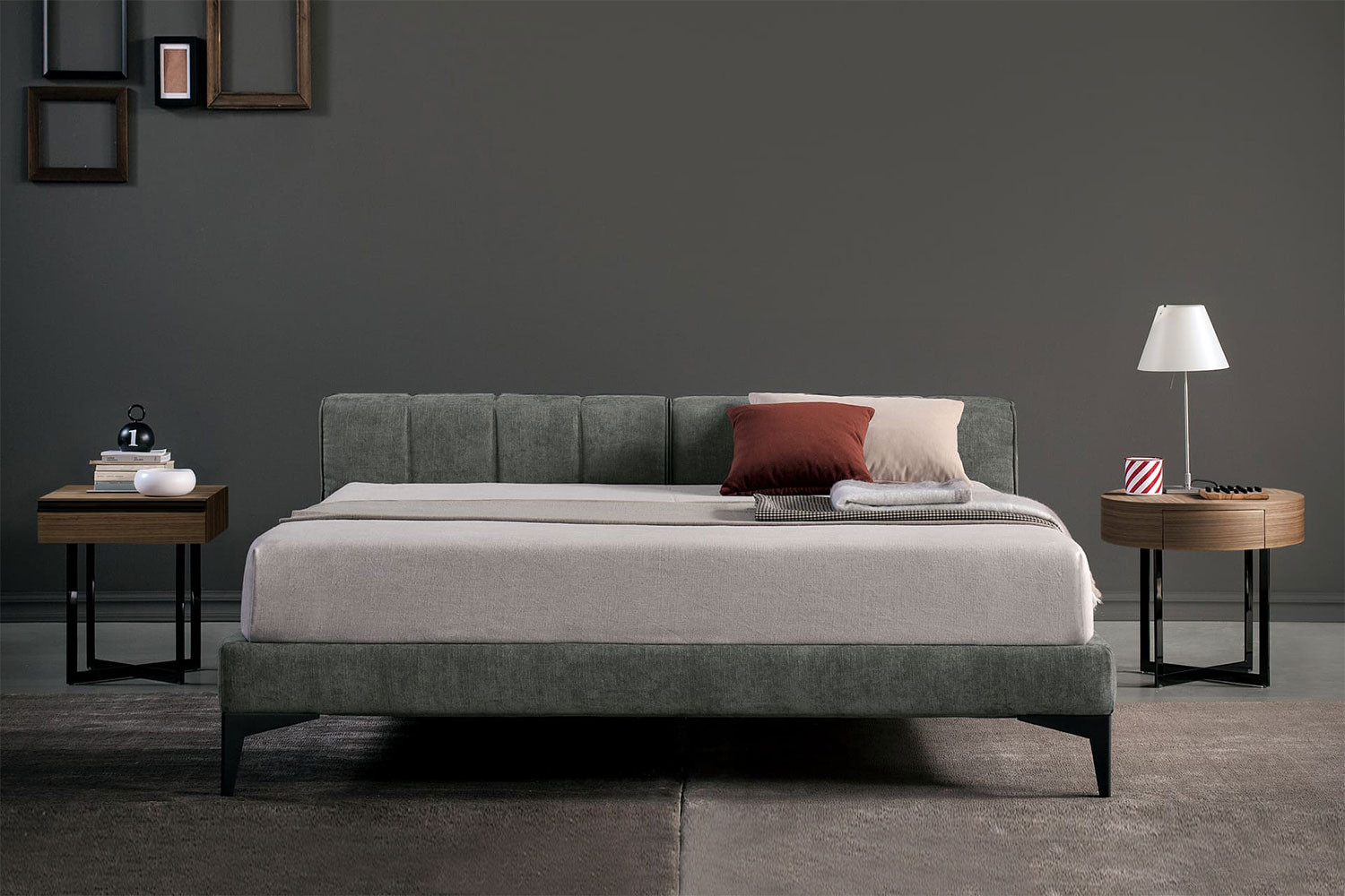 Upholstered king size low headboard bed with high tapered metal legs