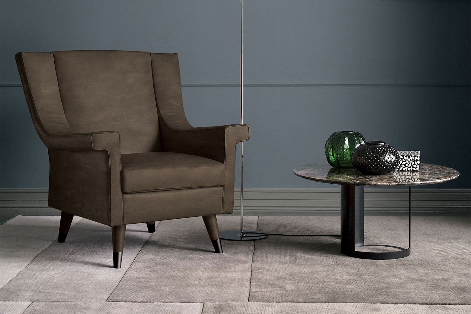 Retro style armchair with splayed legs with tips and slope arms