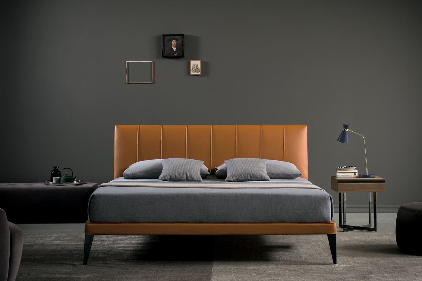 Contemporary king size upholstered platform bed with slatted base and high tapered legs