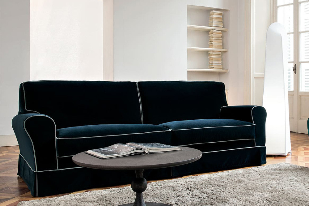 Classic 2, 3 or 4-seater rolled arm skirted sofa enriched with contrasting edge piping