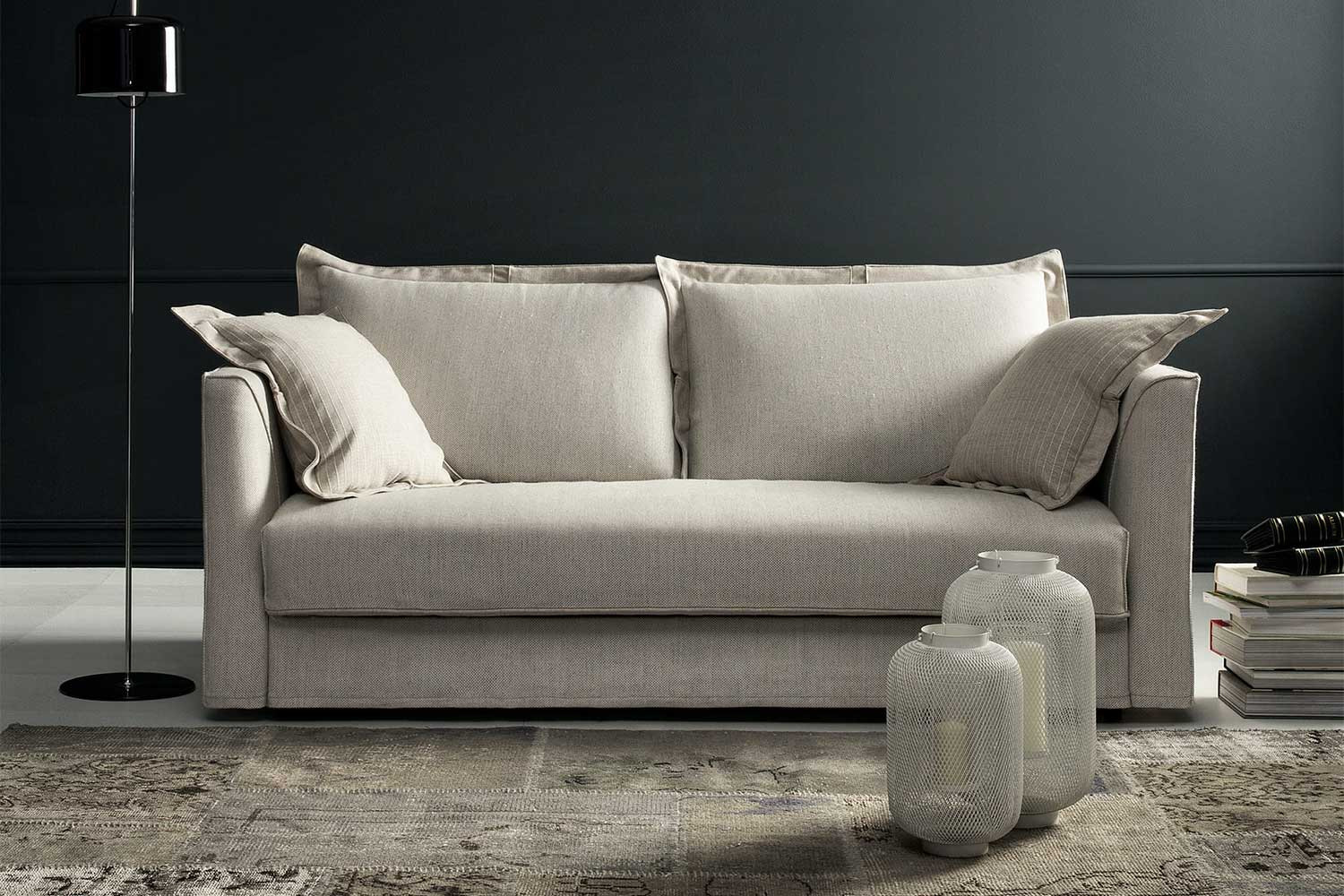 2-3 seater pillow back sofa bed, with loose ruffle-edge cushions and high slim arms