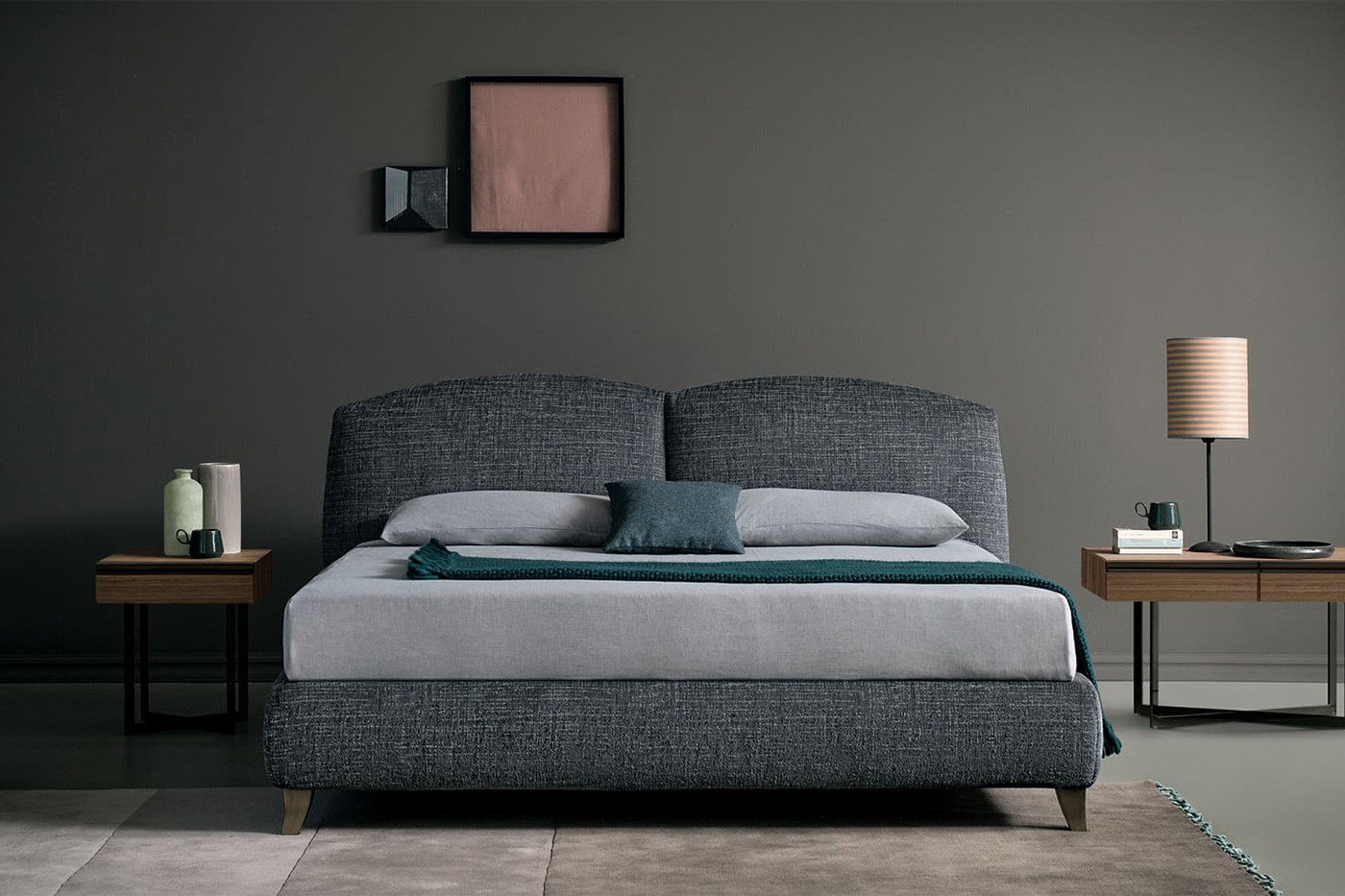 Upholstered king size bed with double cushion headboard and mid-century saber legs