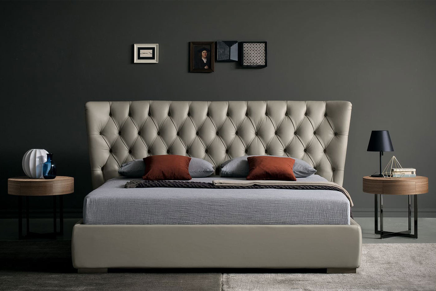King size French-style diamond tufted bed with a tall buttoned winged headboard