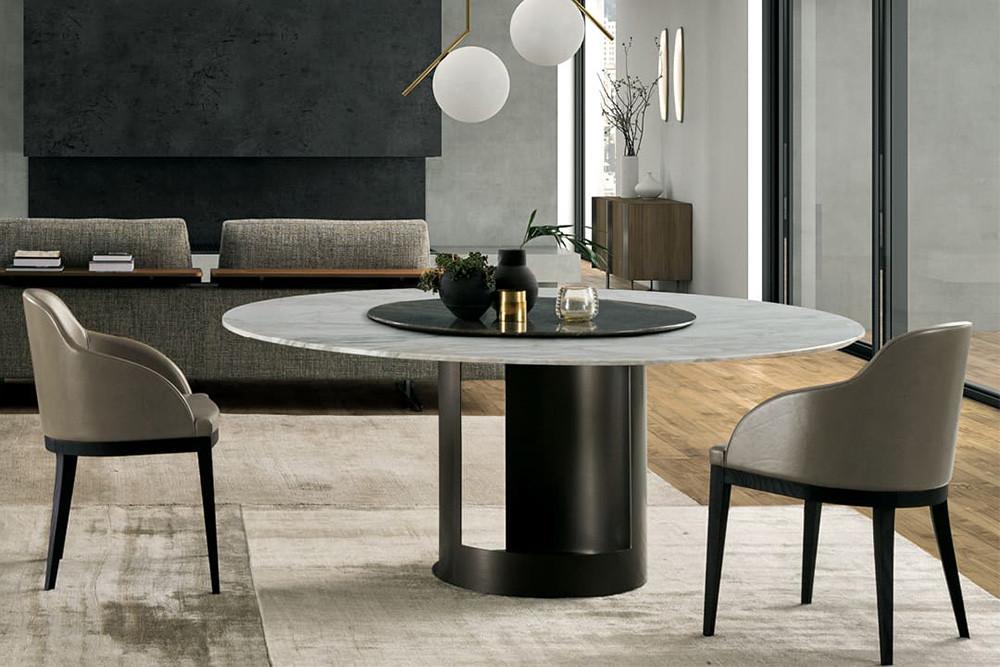 Tavolo rotondo per sala da pranzo con piedistallo centrale in metallo curvato e tagliato a laser